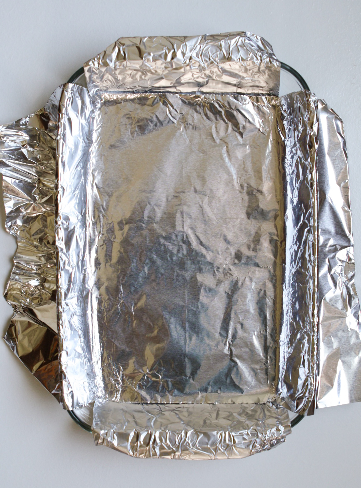 photograph of a foil-lined baking dish