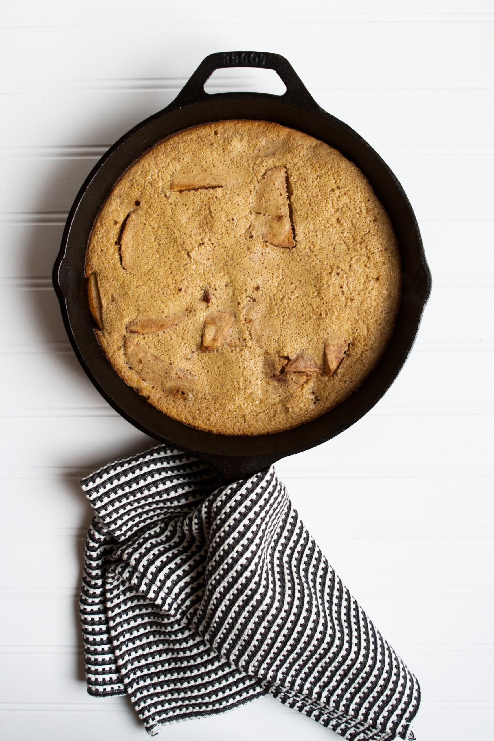 Photograph of puffed pancake in a cast iron skillet