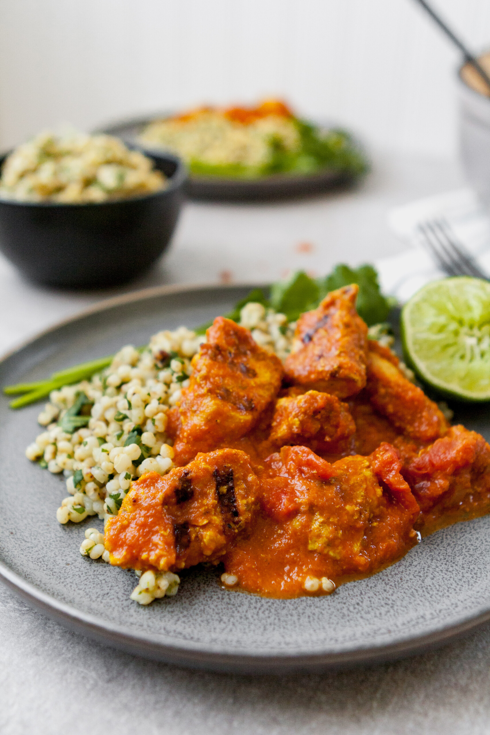 This lightened Chicken Tikka Masala is full-flavored, healthy, and even a great make ahead meal. Atop a bed of cilantro-lime sorghum, this is a classic, reinvented.   from Lauren Grant of Zestful Kitchen