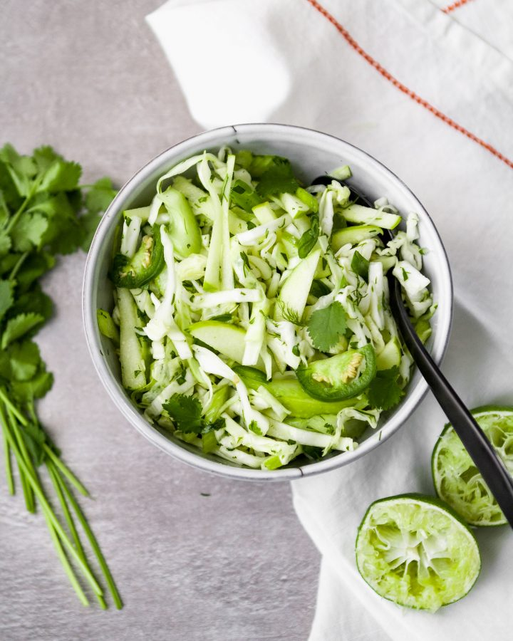 Simple and versatile, this vibrant green slaw makes a perfect side dish or addition to just about any meal. Packed with flavor from cilantro and dill, green apple, jalapeño, and more, this simple slaw is healthy, delicious, and refreshing.   from Lauren Grant of Zestful Kitchen