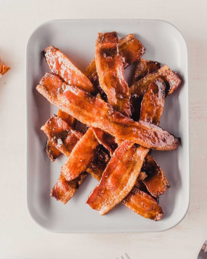 candied bacon on a gray plate