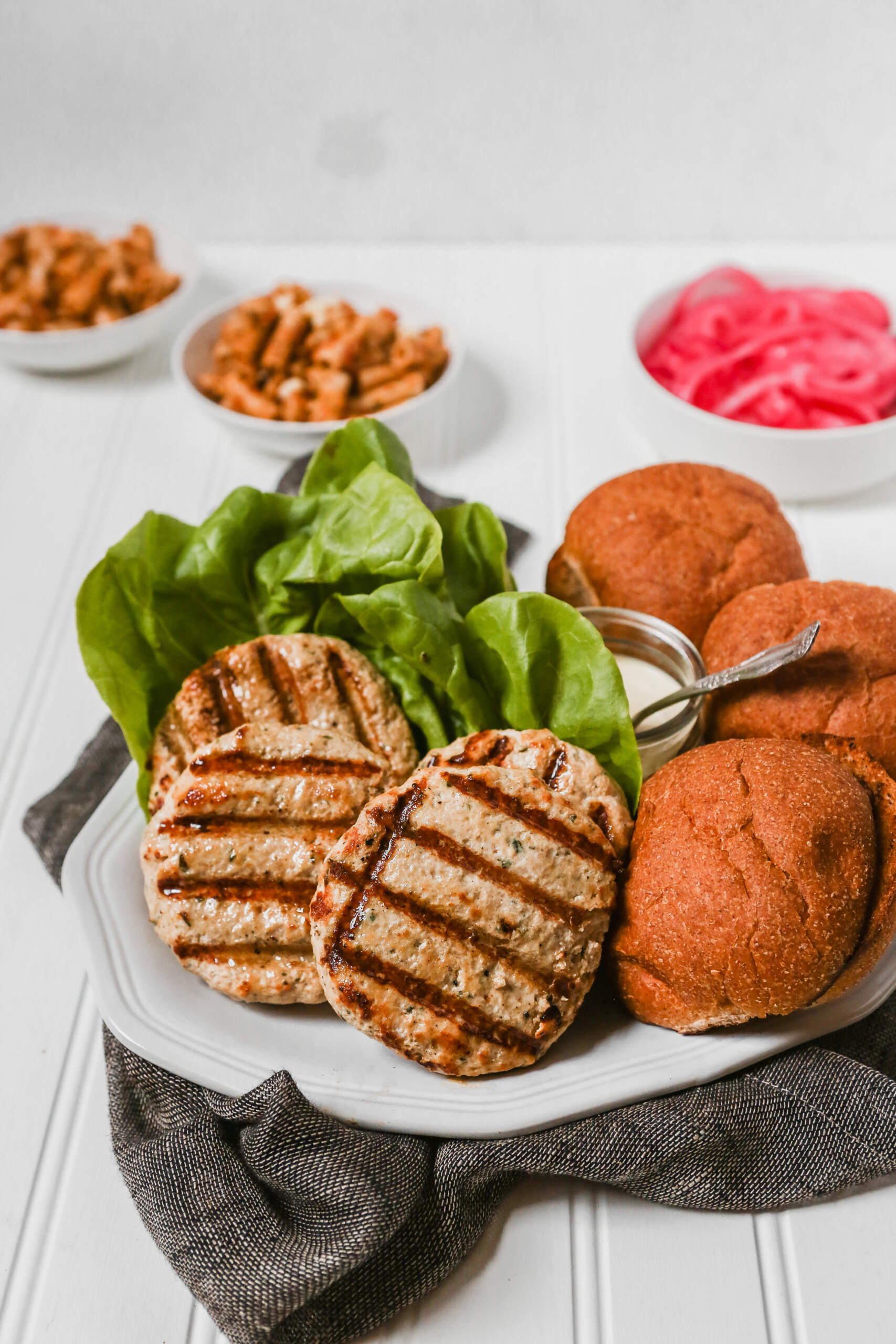 Photograph of turkey burger with steak knife stuck through the top
