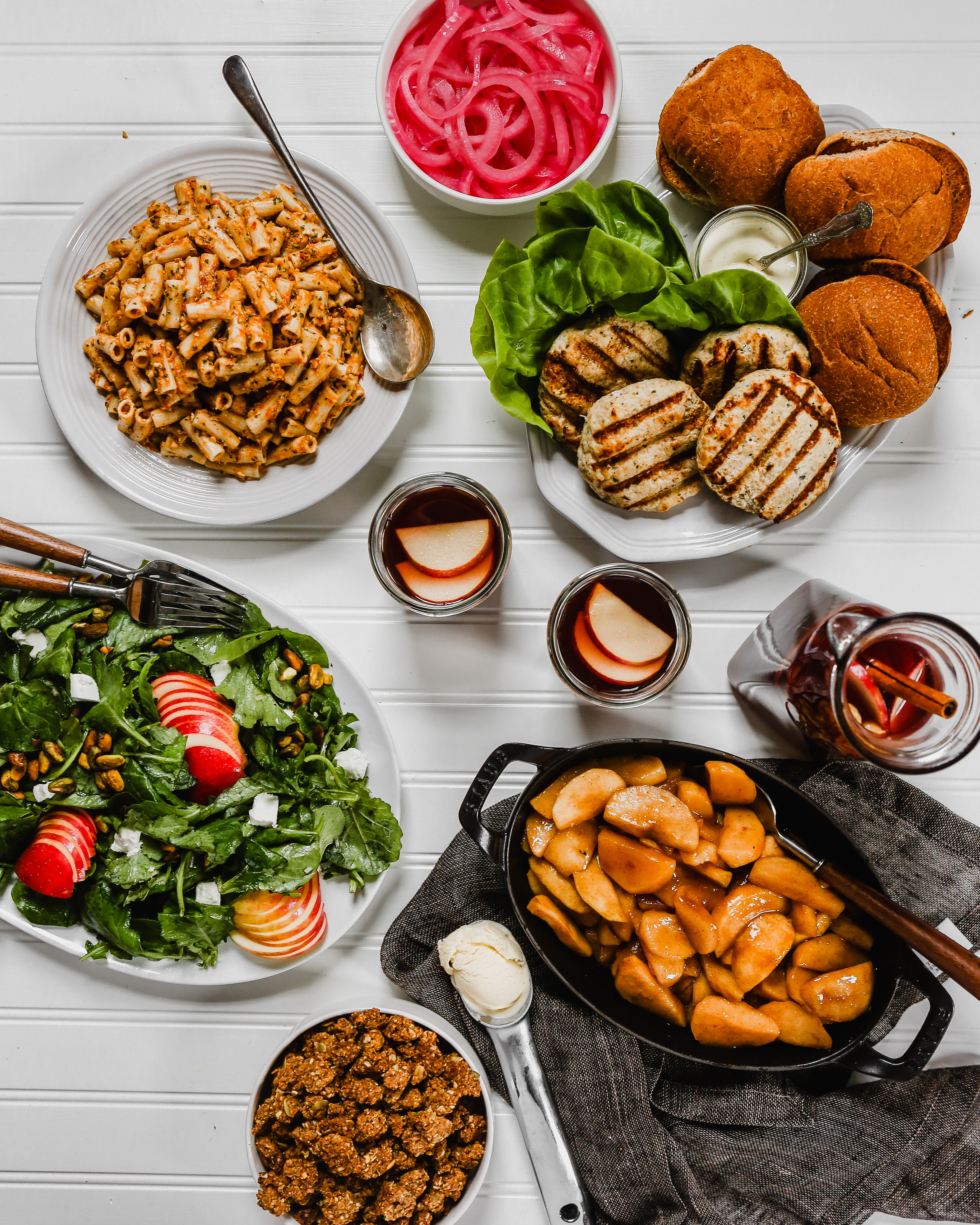 photography of a large spread of food on a white background