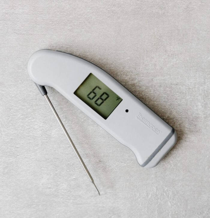 a Thermapen thermometer on a gray table