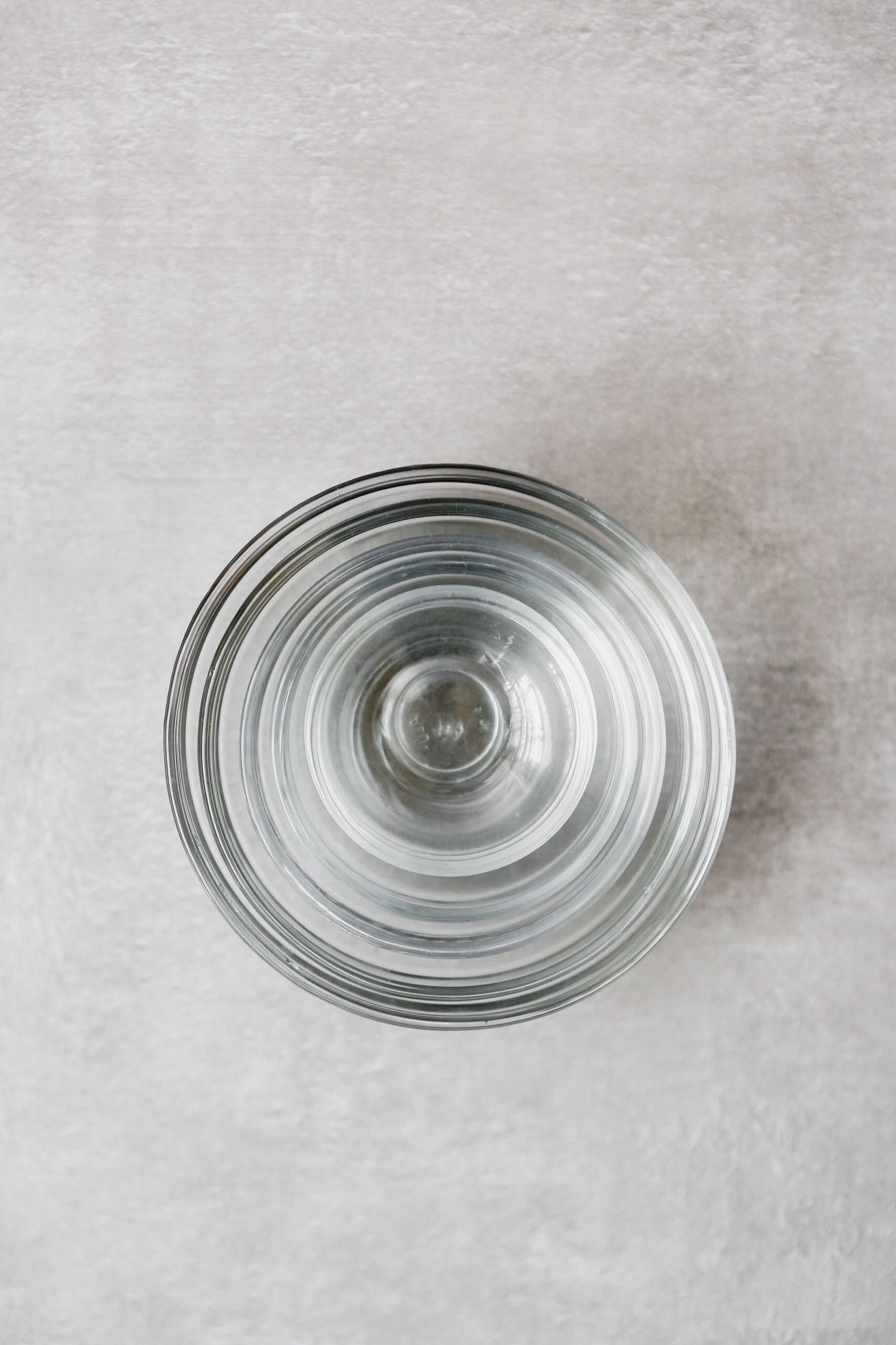 Photograph of stacked mixing bowls on a gray table