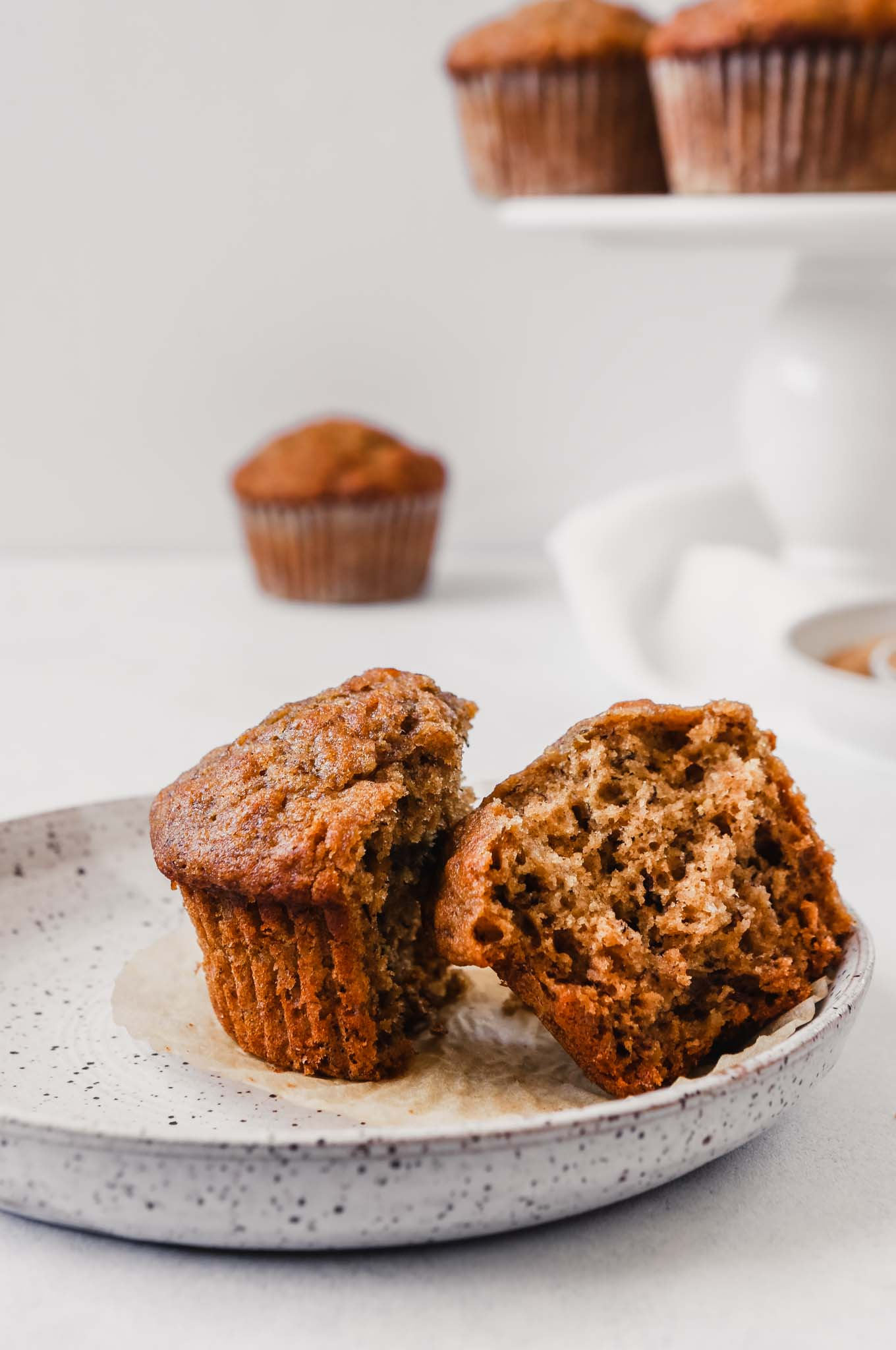 Photograph of banana bread muffin on a plate