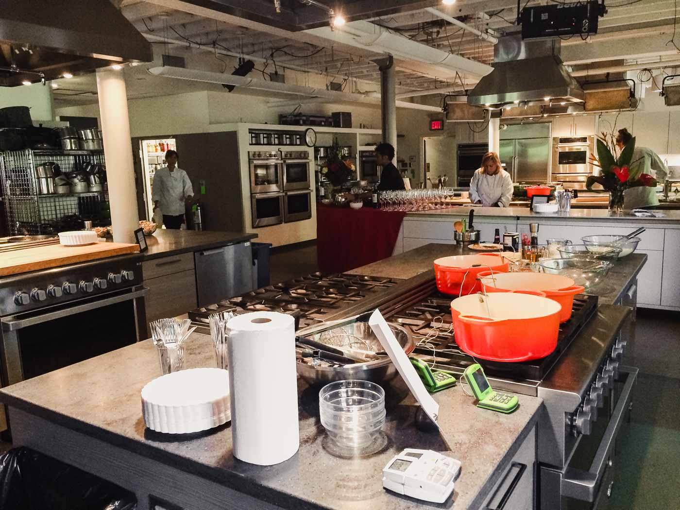 Photograph of America'sTest Kitchen with test cooks testing recipes
