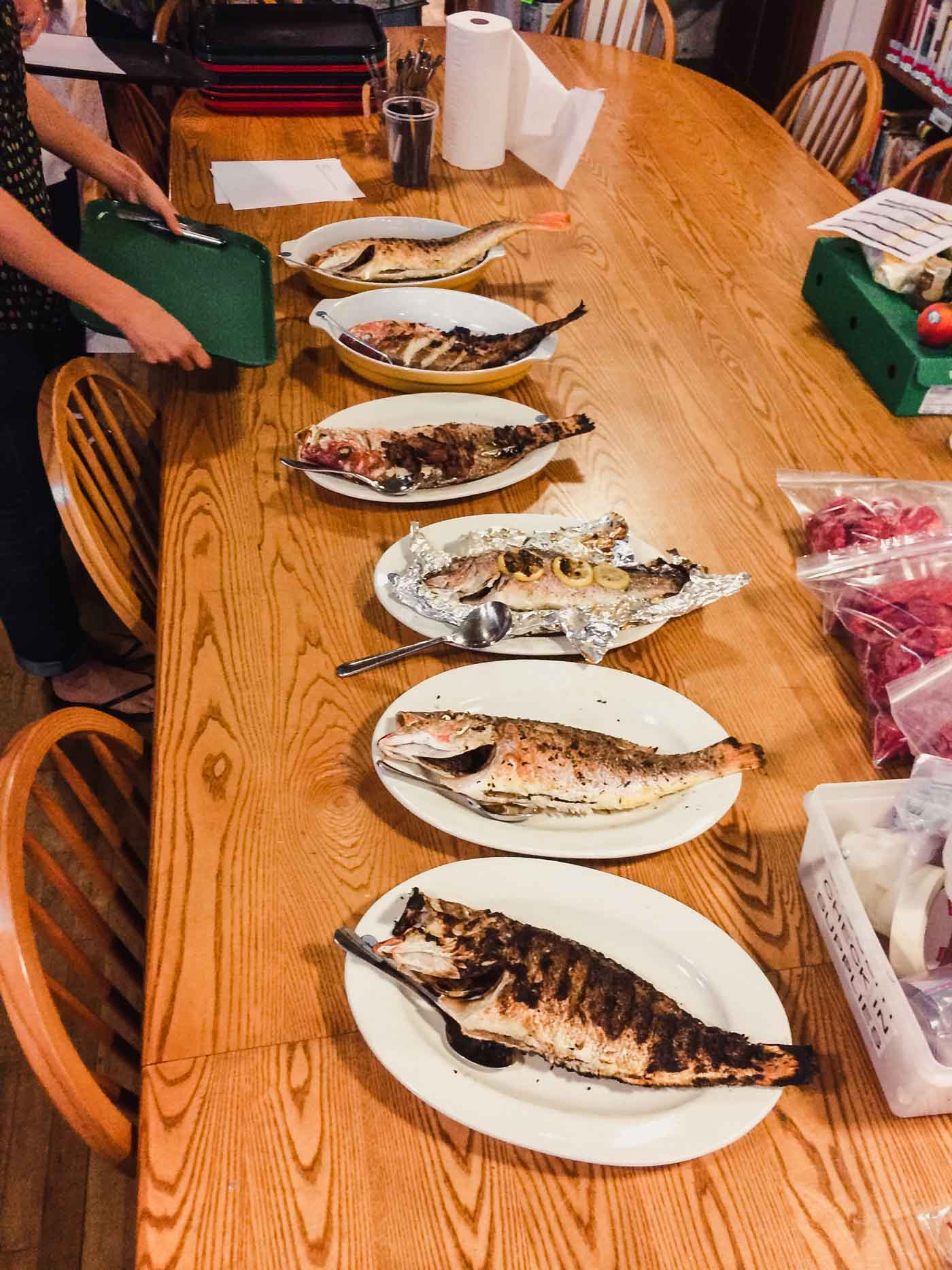 Photograph of a grilled fish taste panel at America's Test Kitchen.
