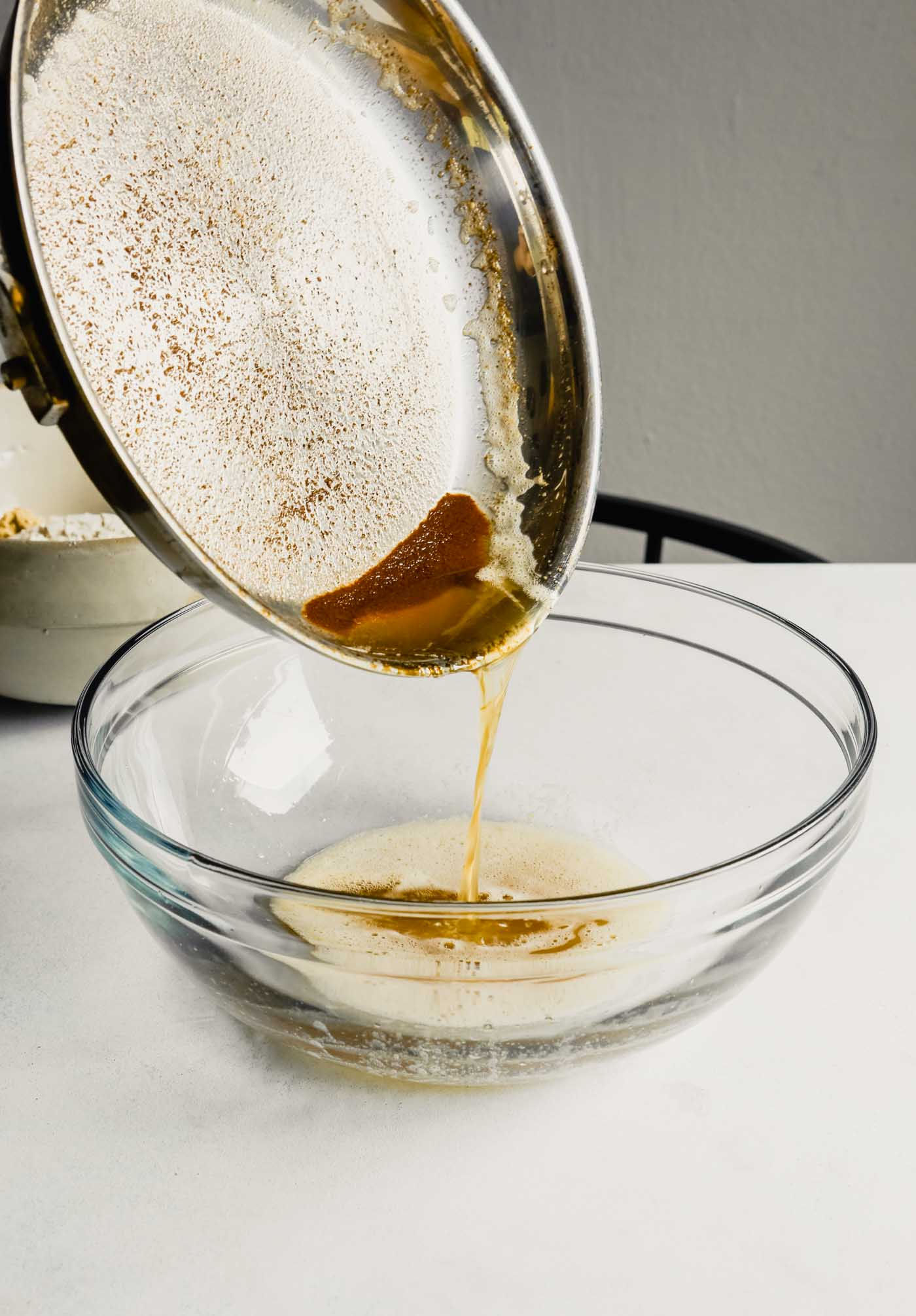 Photograph of brown butter being poured into a large glass bowl