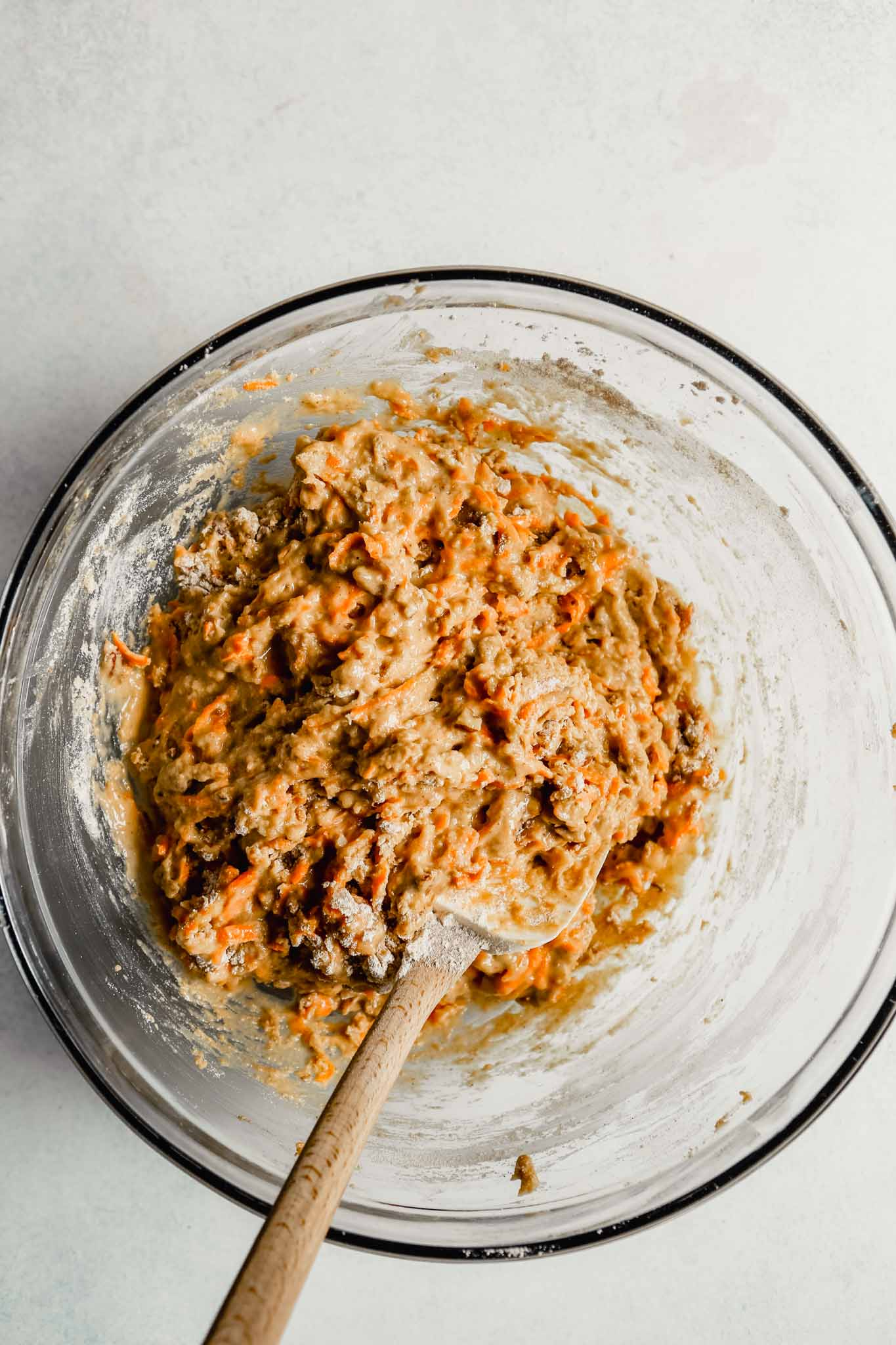 Photograph of carrot bread batter in a large glass bowl