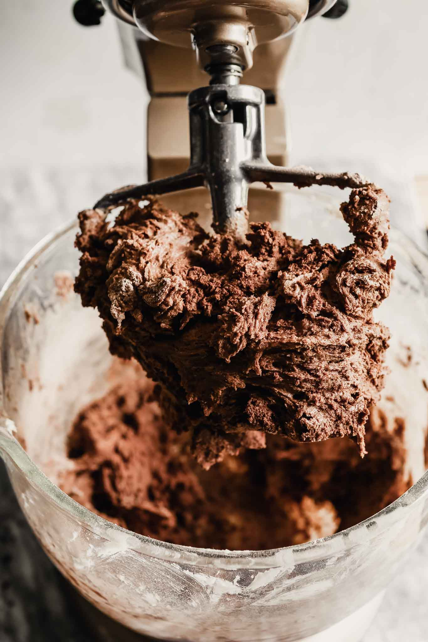Photograph of chocolate cookie dough in a stand mixer