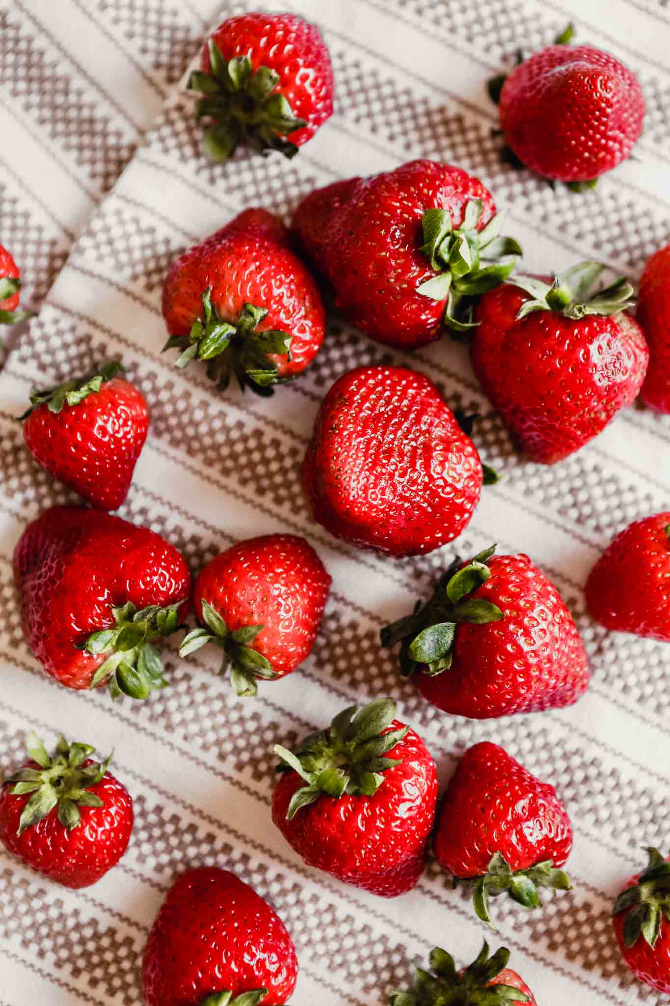 Photograph of fresh strawberries drying on a kitchen towel