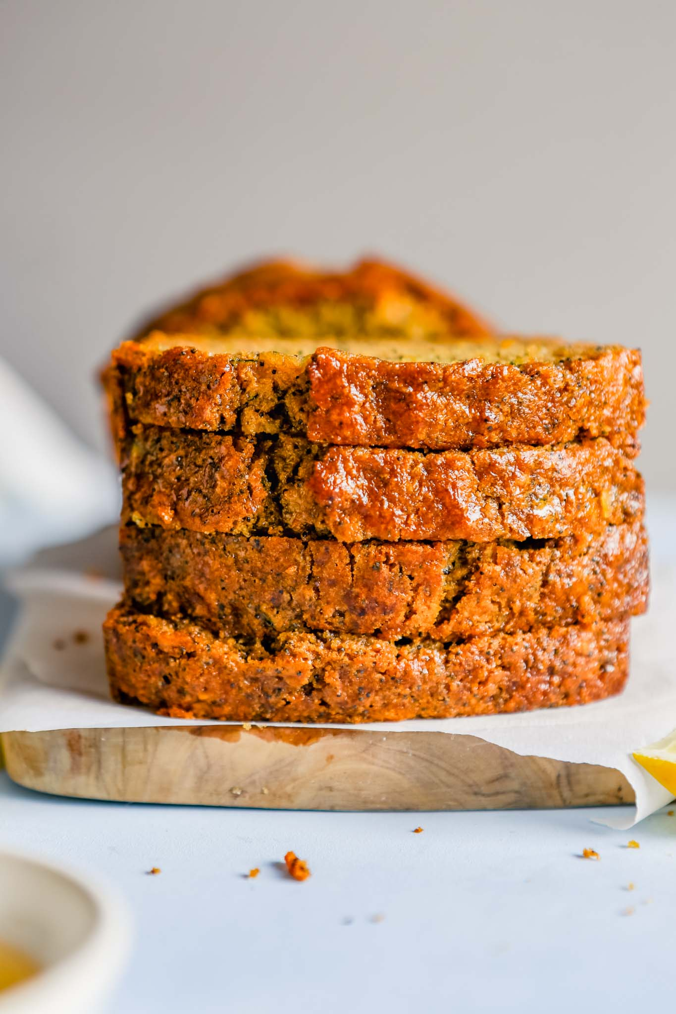 Photograph of slices of lemon zucchini bread stacked on top of each other