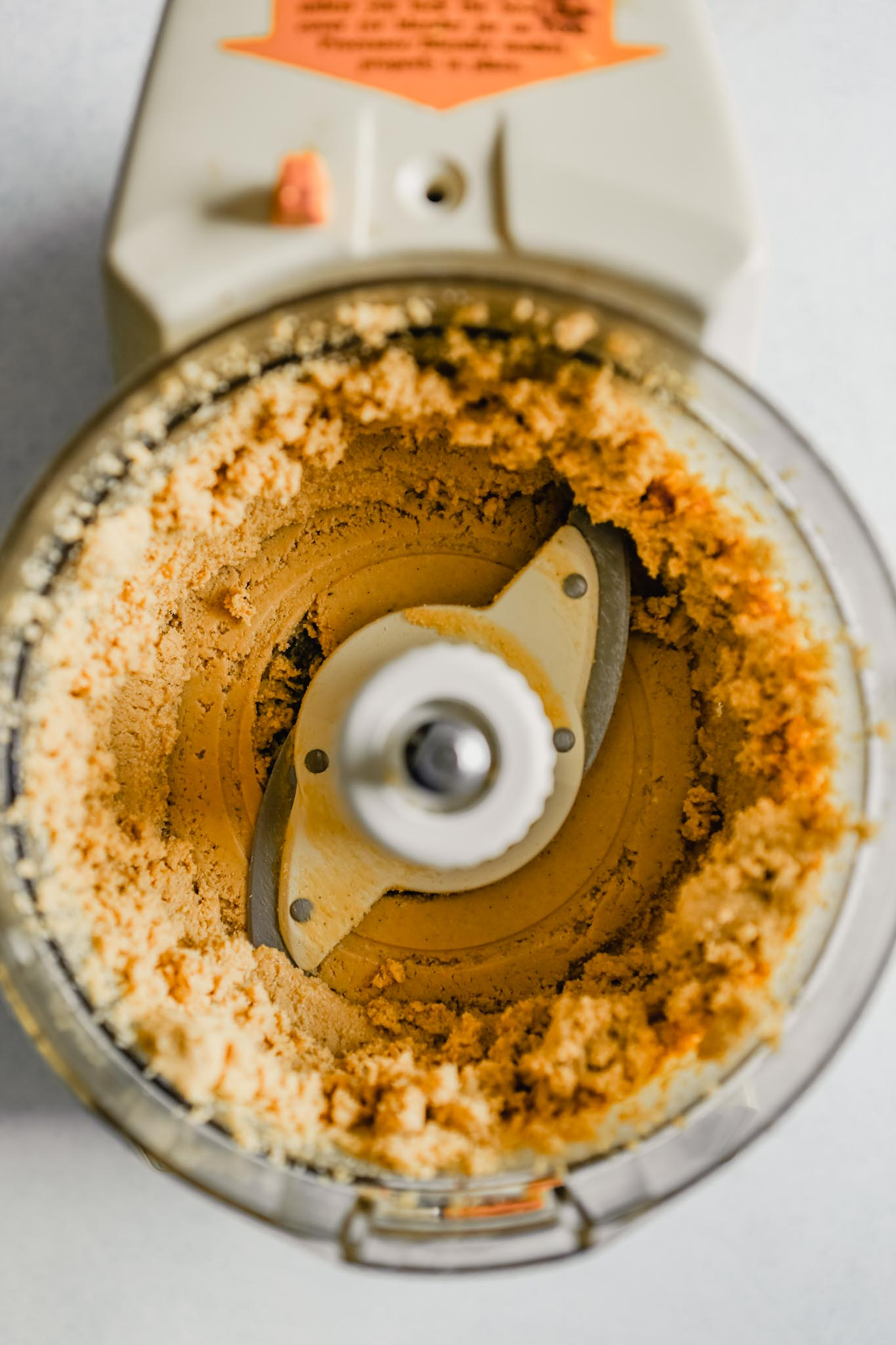 Photo of cashews being blended in a food processor to make cashew butter