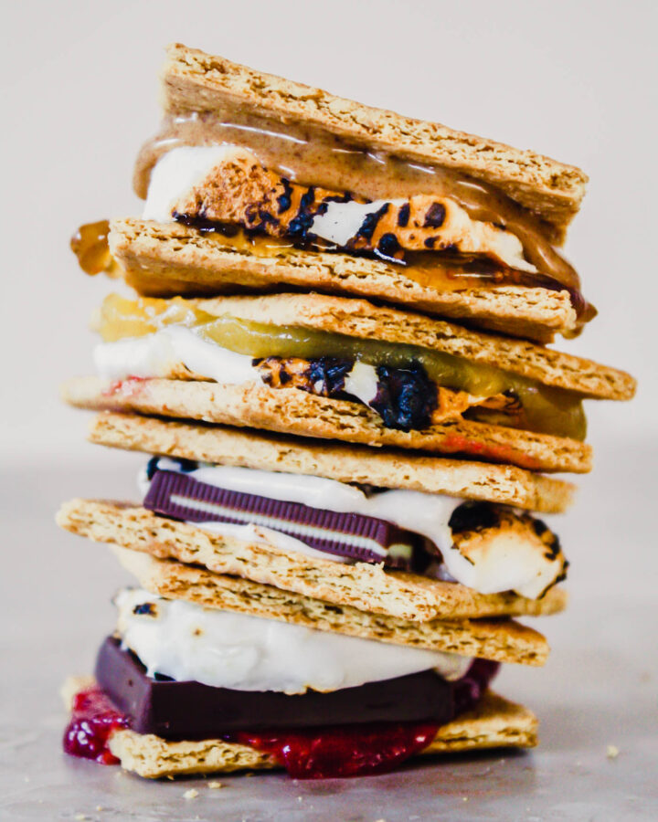 Photograph of s'mores stacked on top of each other on a marble table