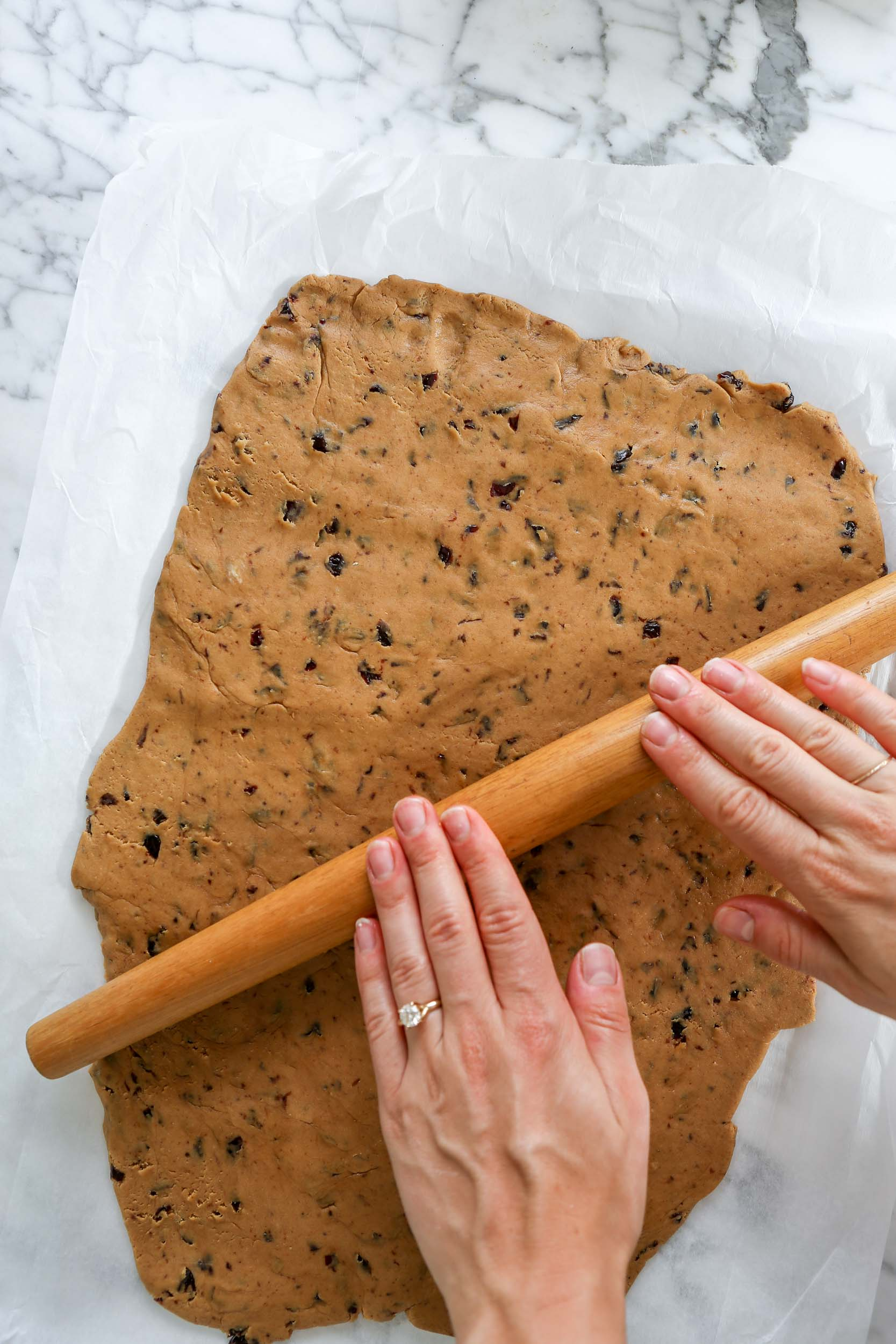 cookie dough spread onto a parchment lined baking sheet
