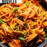 overhead photo of gochujang noodles with recipe title text overlay