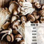 overhead image of various types of mushrooms piled onto a wood table