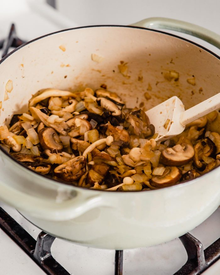 sauteed mushrooms and onions in a pot