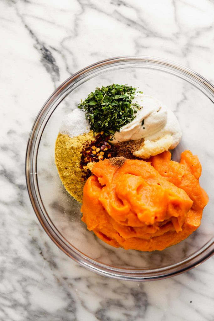 overhead image of vegan ravioli filling in a bowl (featuring sweet potato puree, cashew cream, herbs, nutritional yeast)