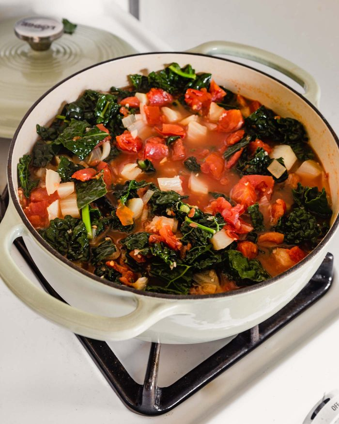 photo of detox soup in a large Dutch oven on the stove top