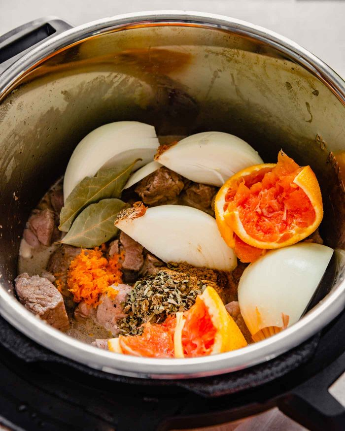 photo of seared pork with spices, onion wedges and orange halves photo of pork being seared in an Instant Pot