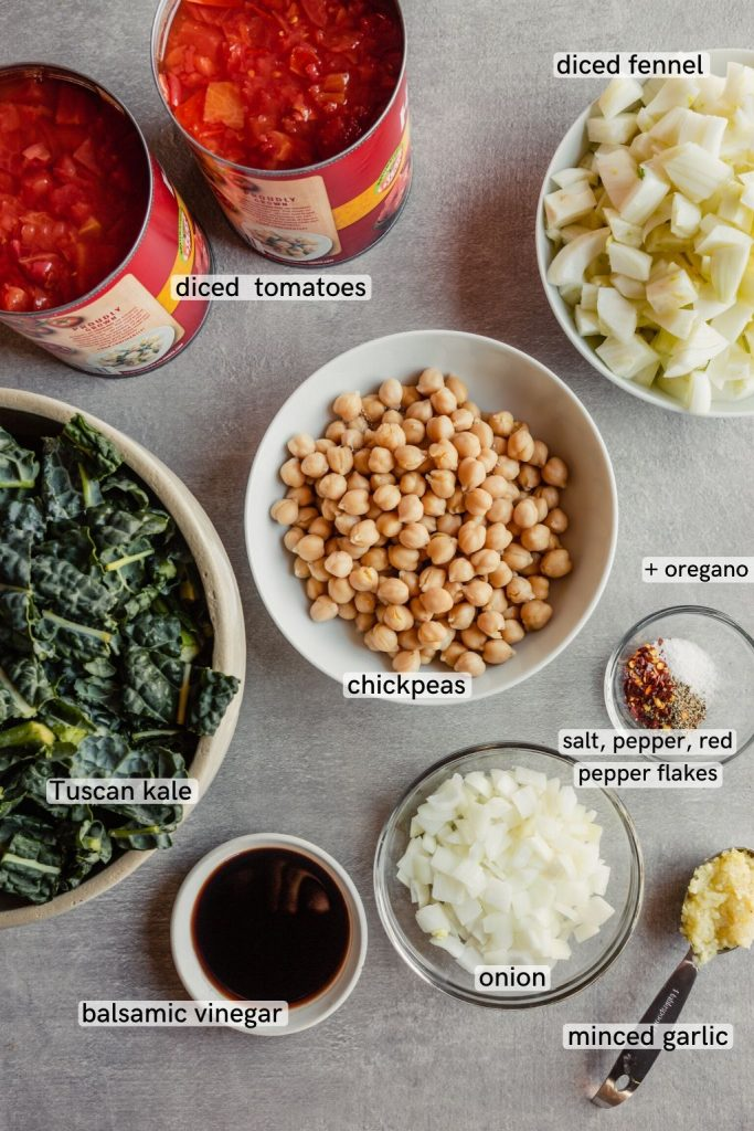 Overhead image of detox soup ingredients laid out on a gray table