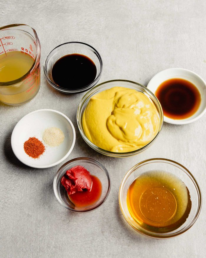 ingredients in glass bowls arranged on a gray counter