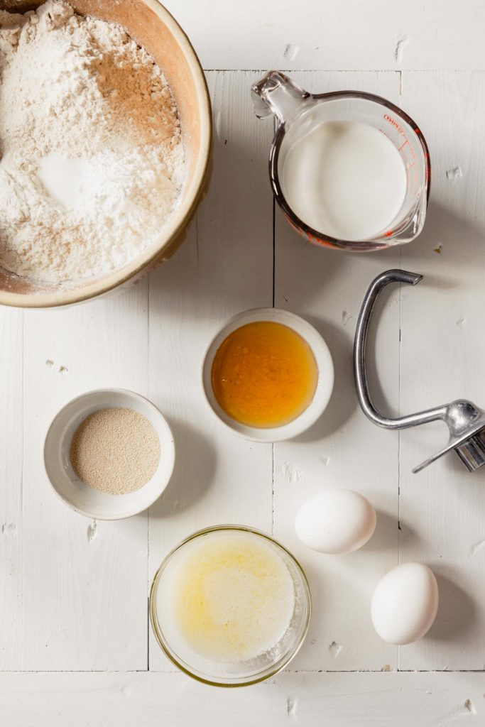 Overhead image of ingredients set out on a white table