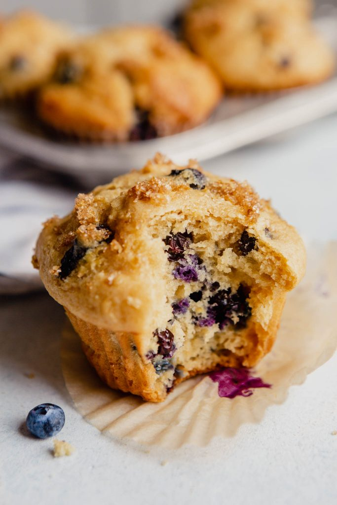 image of a blueberry lemon muffin with a bite taken out of it