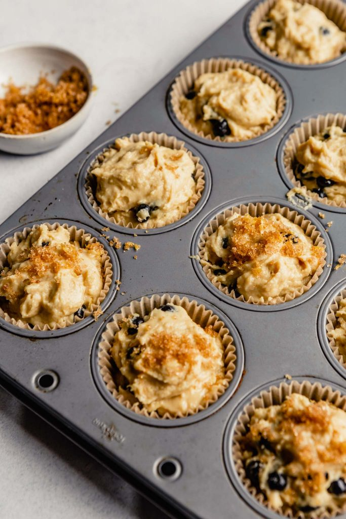 muffin batter in paper liners topped with sugar