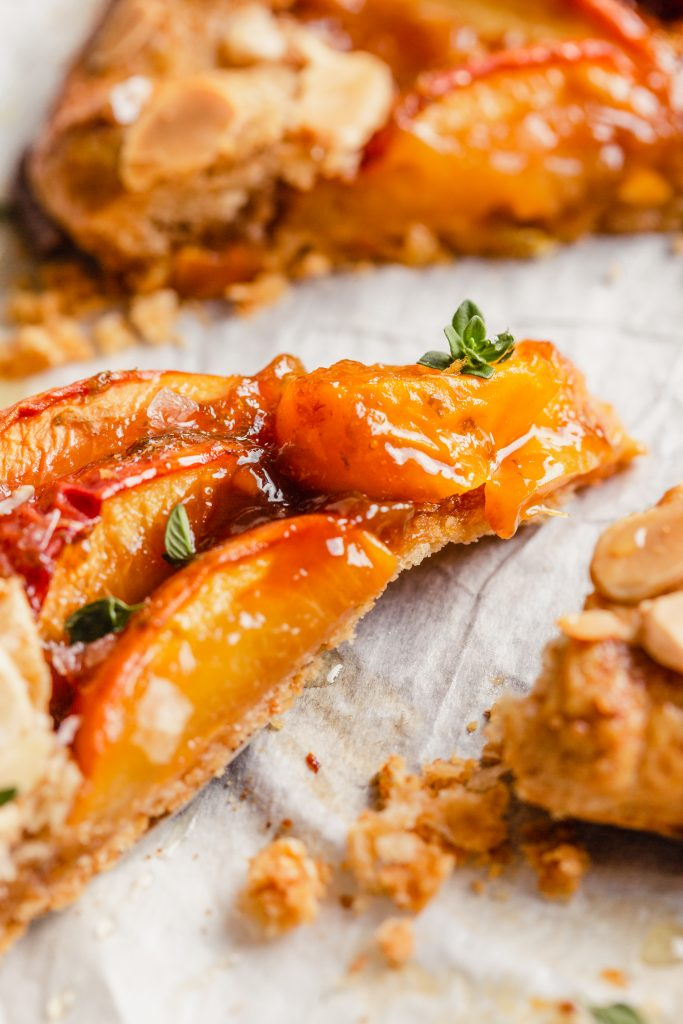 close up picture of the juicy peach filling of a peach galette