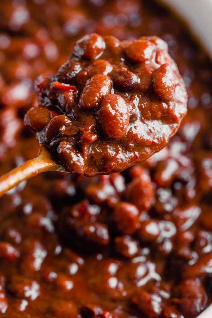 close up of baked beans on a spoon