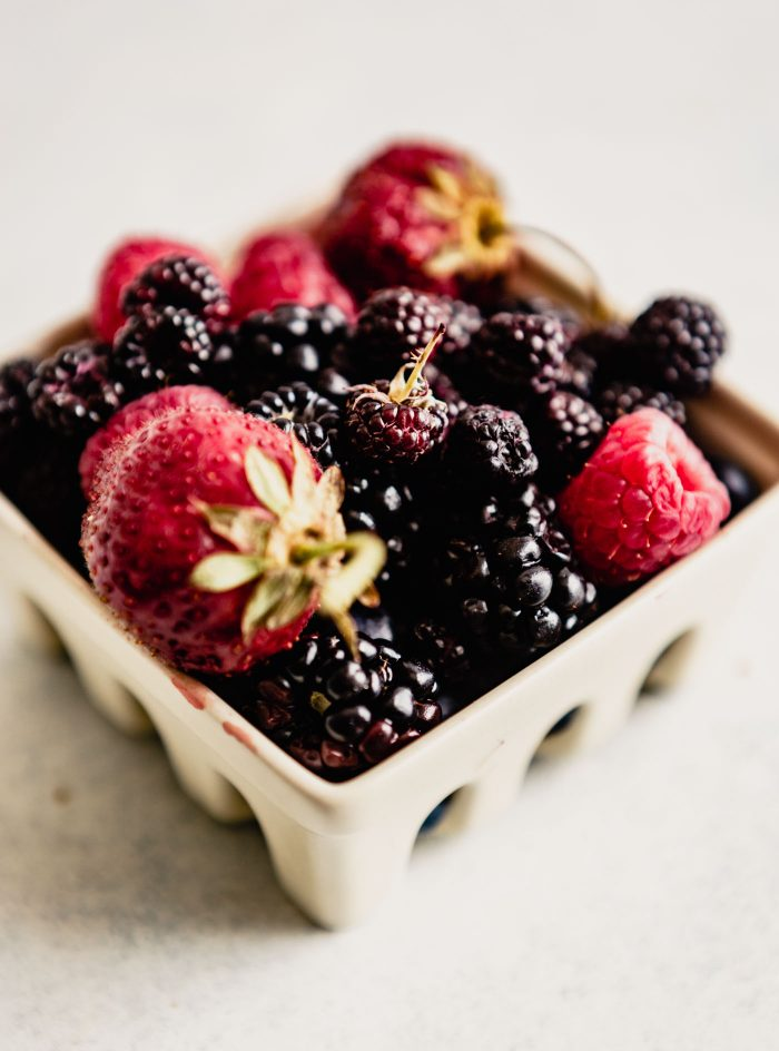 berries in a white container