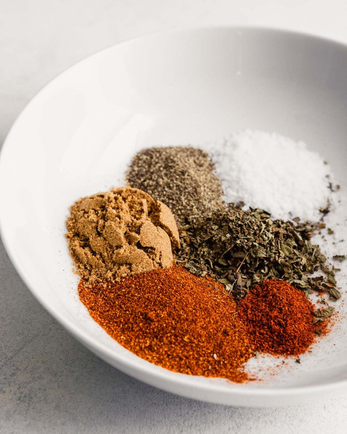 spices measured out in a white bowl