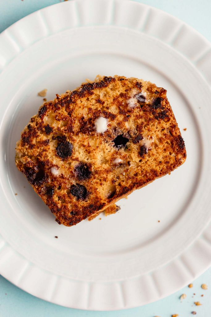 toasted piece of lemon blueberry bread on a plate