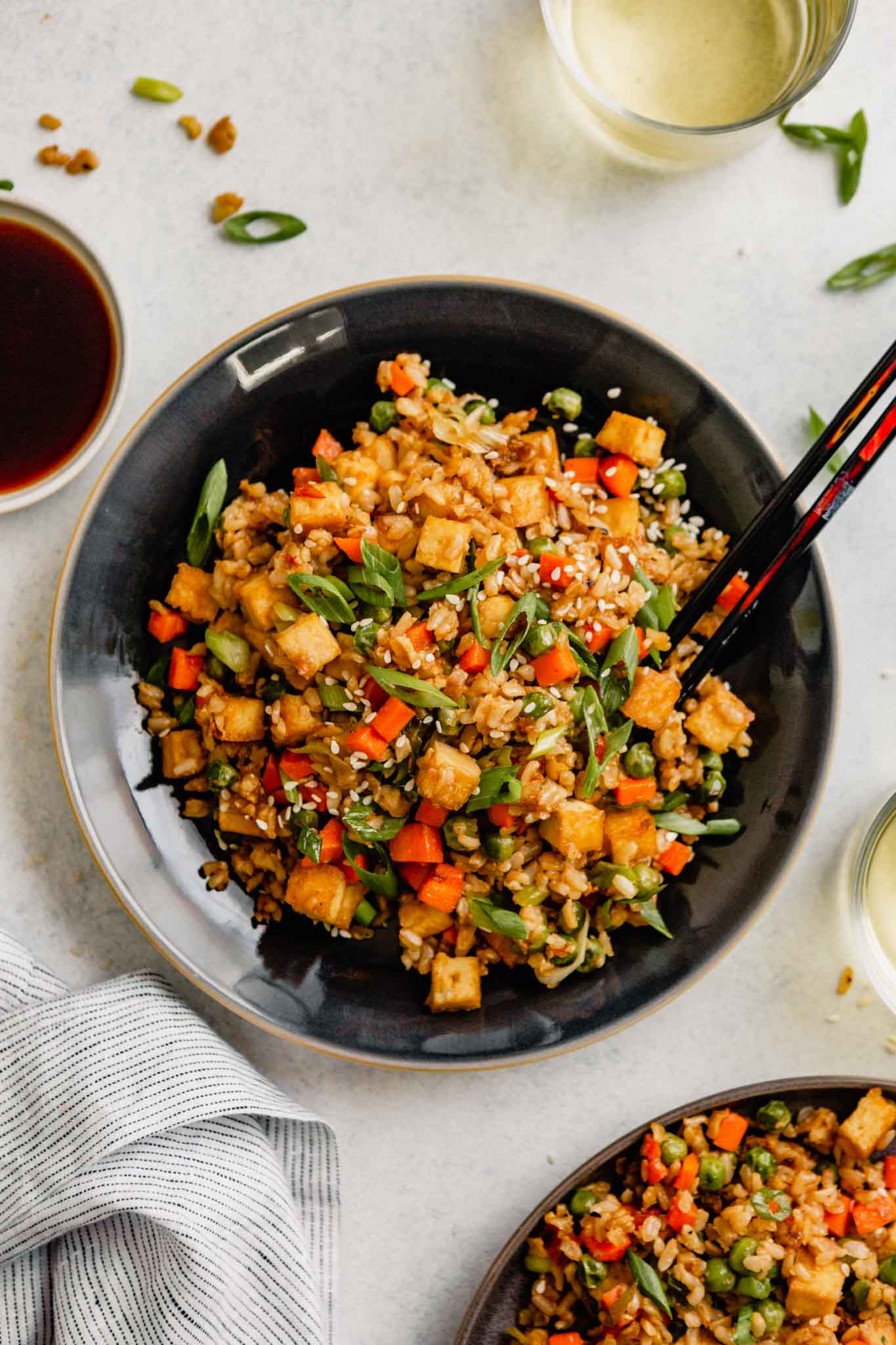 fried rice in a large blue bowl with chopsticks