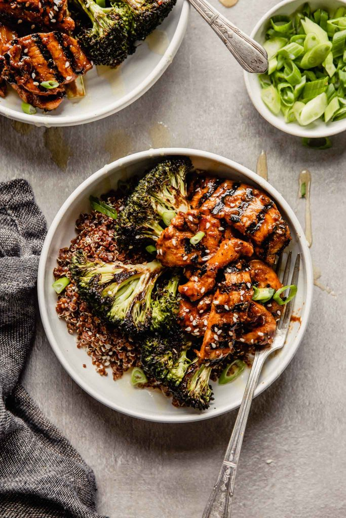 bulgogi beef bowls (or chicken bowls) filled with quinoa and topped with roasted broccoli and charred meat