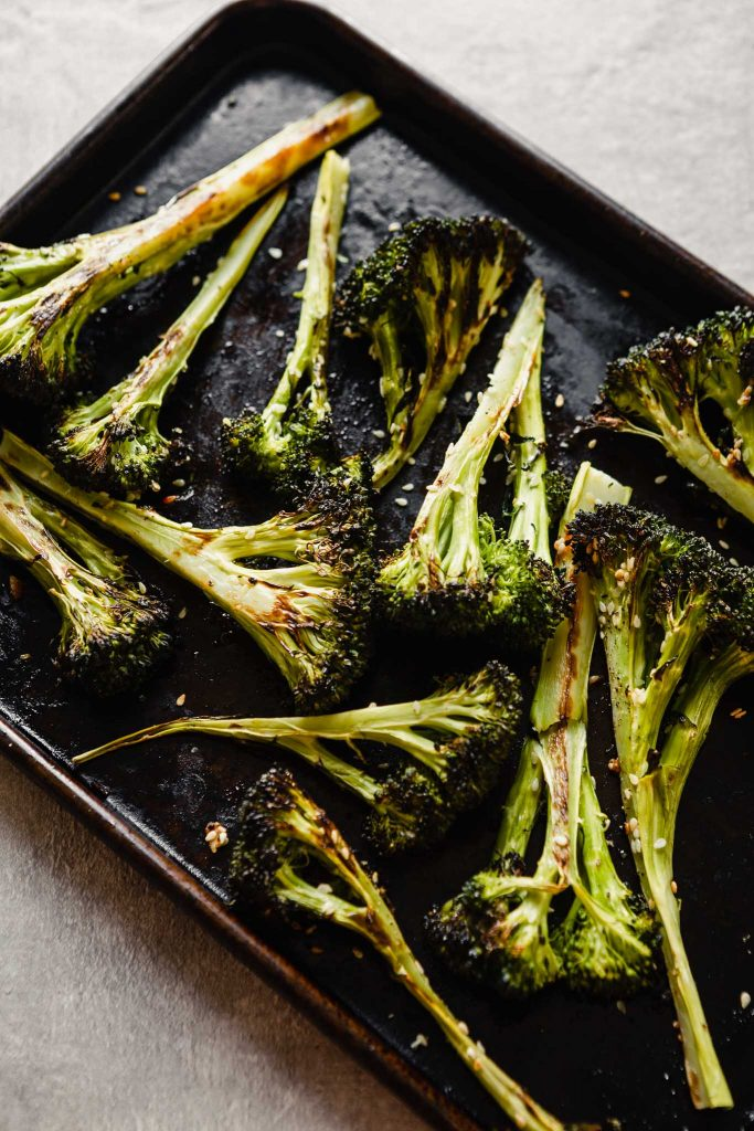 roasted broccoli wedges on a baking sheet