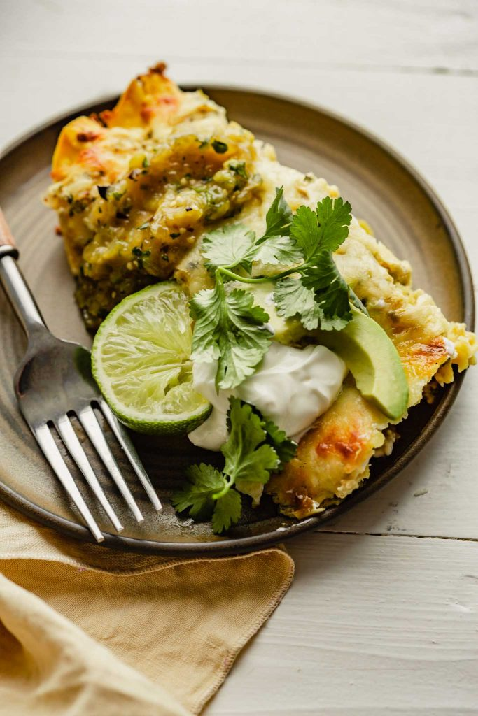 image of enchiladas verdes on a brown plate set on a white table