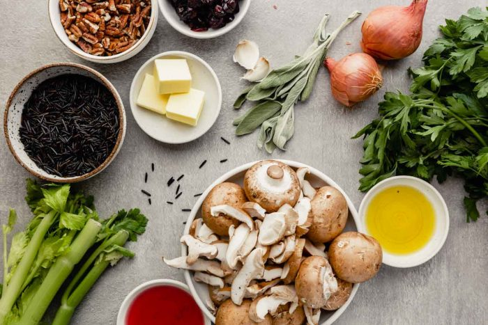 overhead image of ingredients for wild rice stuffing set on a gray table