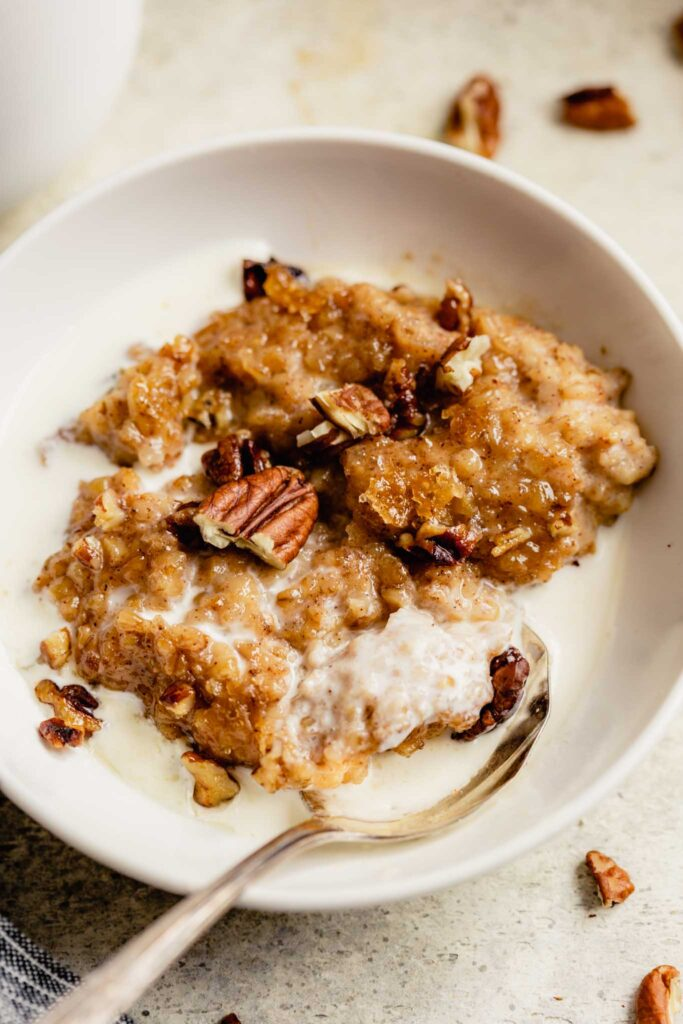 oatmeal, nuts and cream in a small white bowl