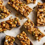 cereal bars and wood-handled knife arranges on white parchment paper