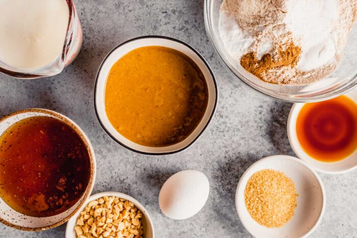 peanut butter, honey, buttermilk, flour and spices measured out in bowls on a table