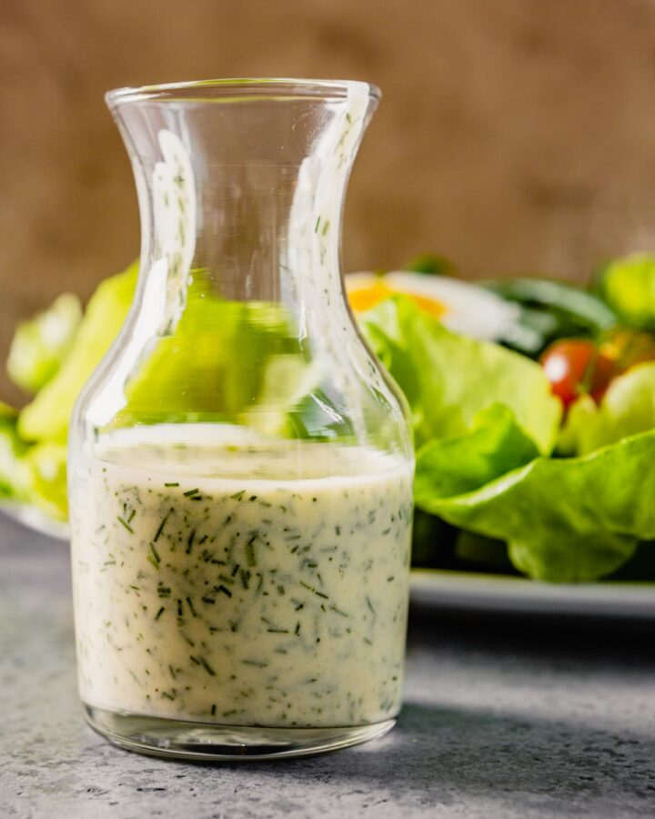 small glass vase filled with ranch dressing