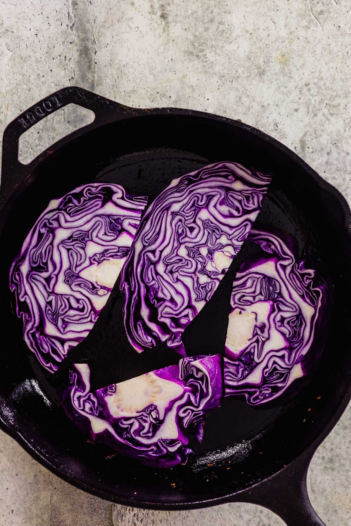 planks of cabbage in a cast-iron skillet