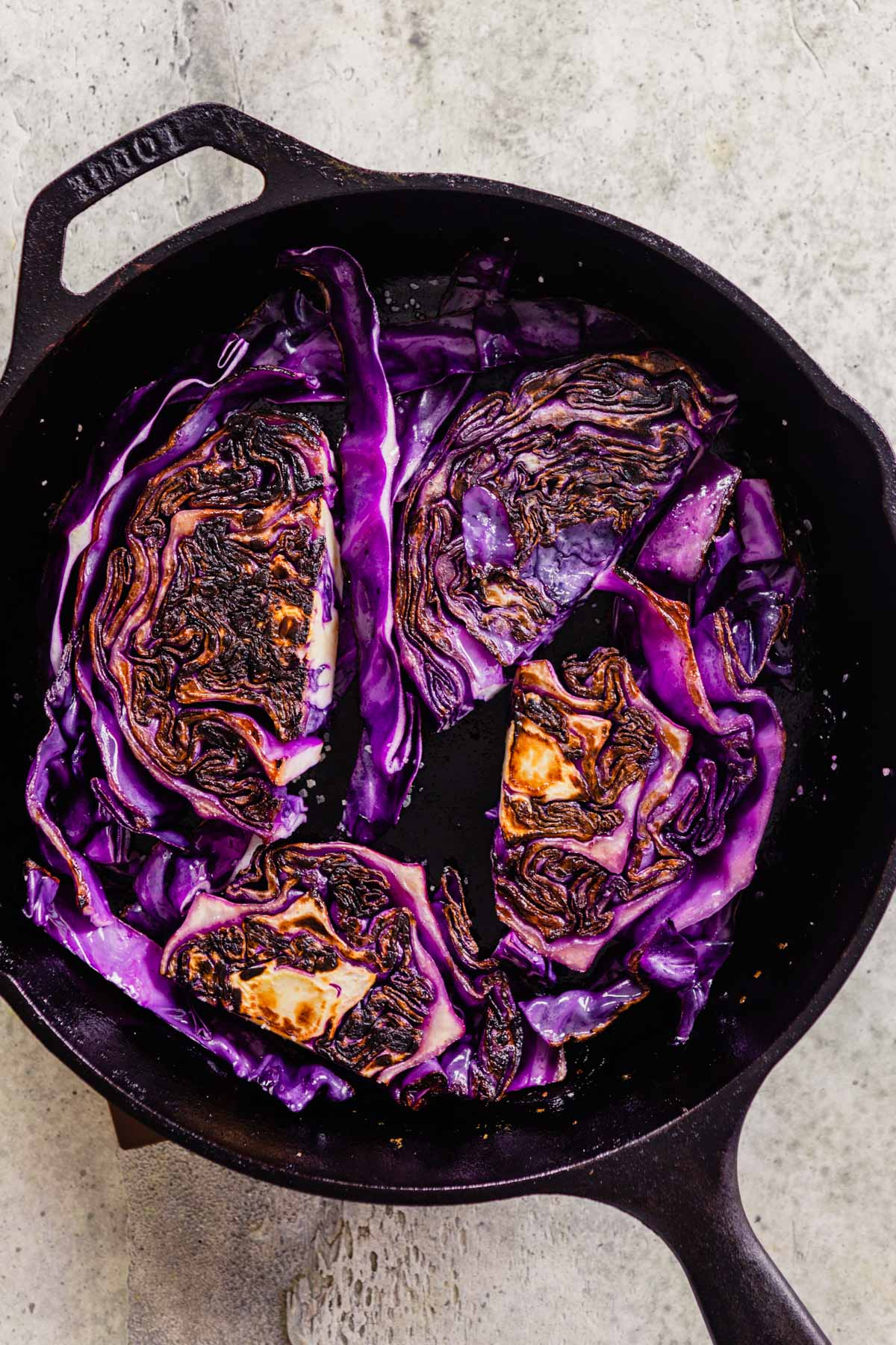 cabbage frying in a cast-iron skillet